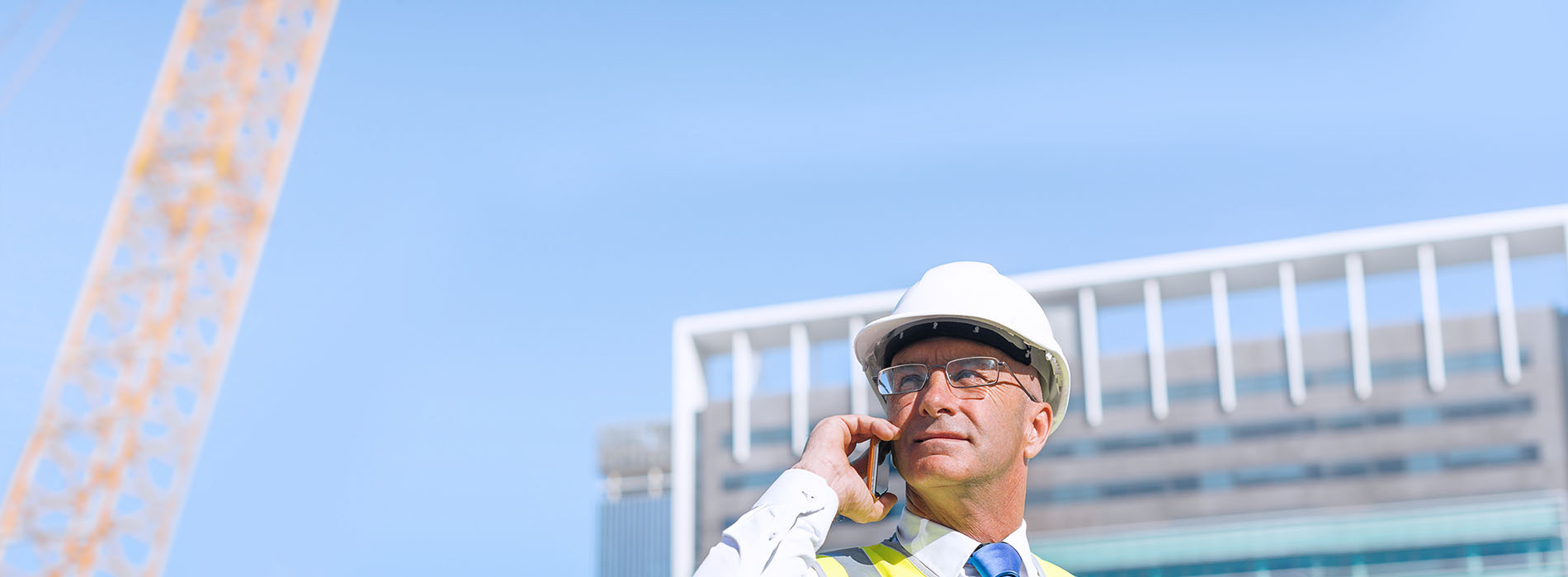 Construction worker talking on smartphone